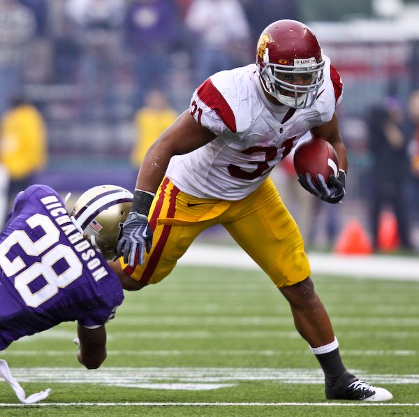 USC's Stanley Havilli tries to break away from UW's Quinton Richardson