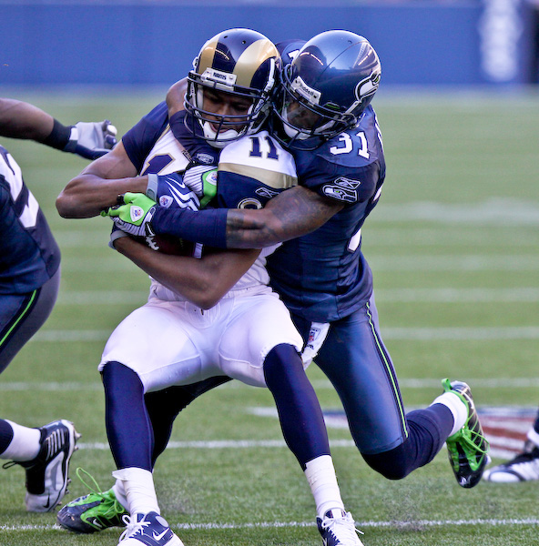 Seahawks CB Ken Lucas wraps up Rams WR Laurent Robinson after a catch in the 4th quarter. Sept. 13, 2009 - Qwest Field, Seattle
