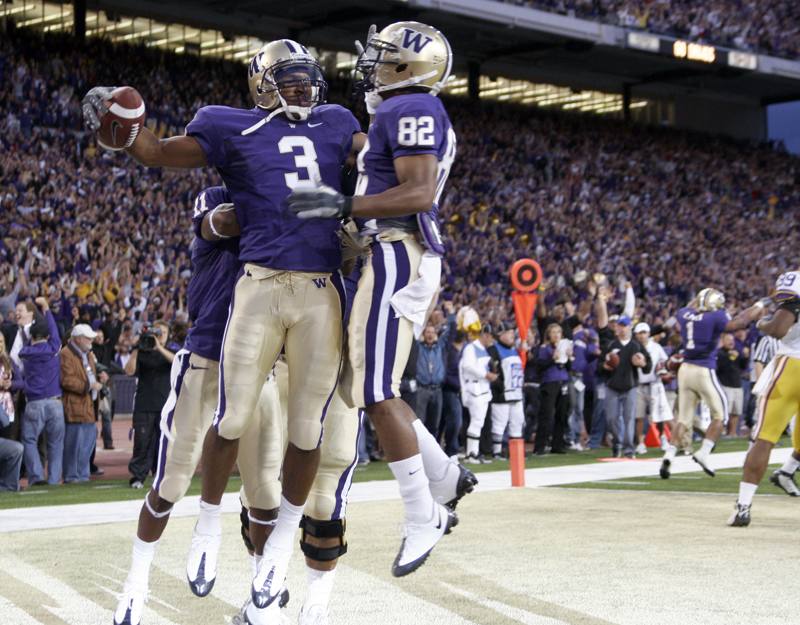 Washington WR James Johnson celebrates with teammates after scoring on the game's opening drive.