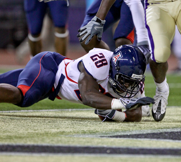 Greg Nwoko dives into the endzone for a Wildcat touchdown.