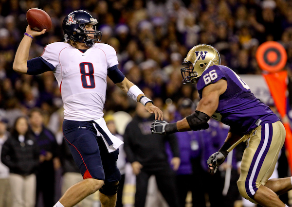Arizona's Nick Foles tries to get a pass off with Daniel Te'o-Nesheim bears down on him.