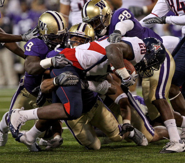 Greg Nwoko is finally brought down by a swarm of Huskies.
