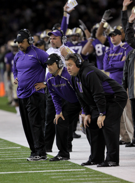 The Washington coaches are on the edge as a play unfolds