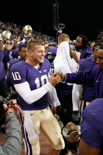 Jake Locker celebrates with his teammates.