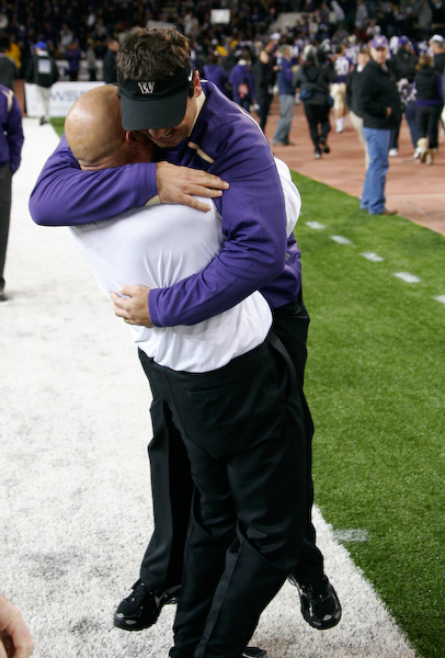 Head Coach Steve Sarkisian and assistant Nick Holt hug after and amazing win.