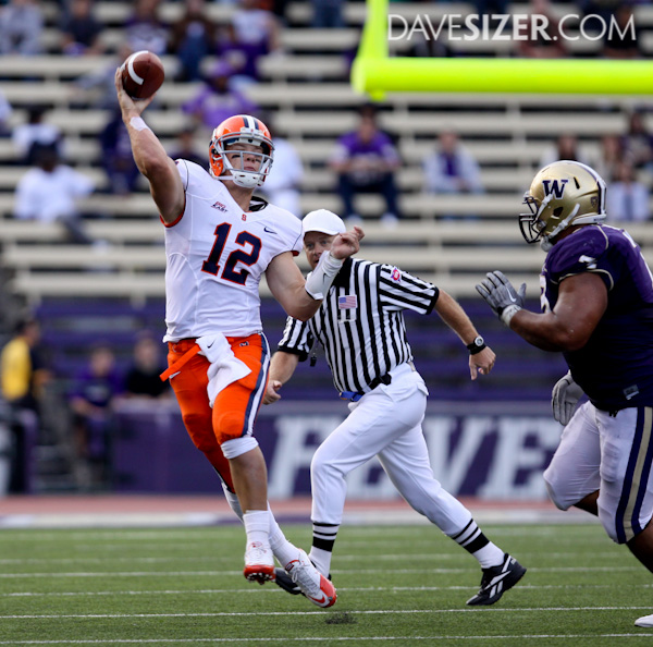 Orange QB Ryan Nassib scrambles away from the Washington Defense to get a pass off