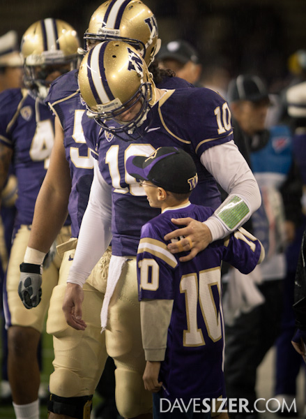 *Extra* Jake Locker chats with a young fan before the game.