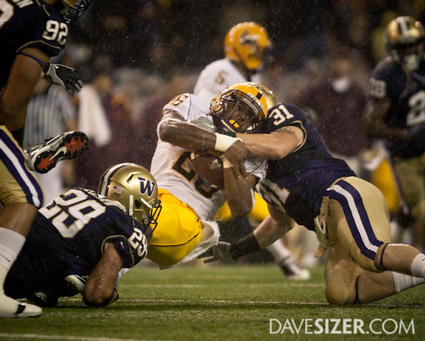 ASU's Cameron Marshall gets wrapped up by Cort Dennison