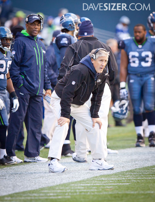 Pete Carroll looks on to the action.