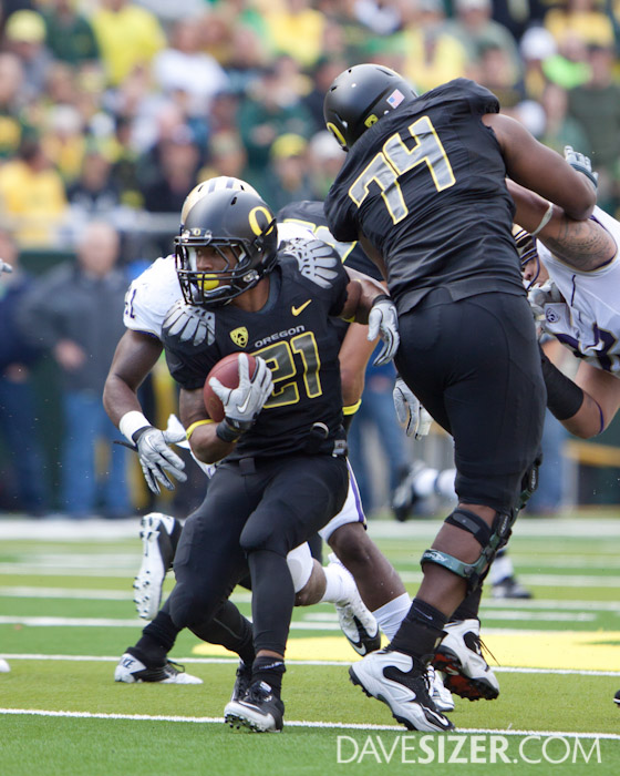 LaMichael James works though the Husky defense.