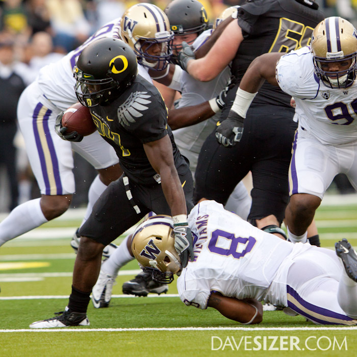 Kenjon Barner fights off Nate Williams.