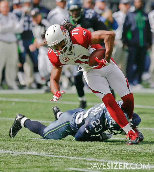 Larry Fitzgerald tries to break free of Marcus Trufant.