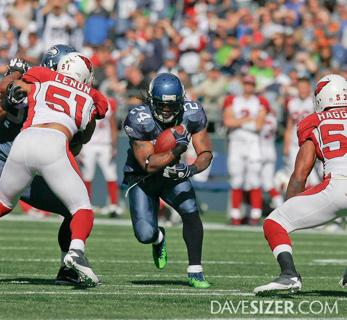 Marshawn Lynch busts through the Cardinals Defense.
