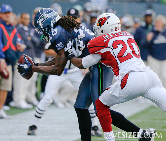 Sidney Rice hauls in a pass on the sideline and is pushed out by AJ Jefferson.