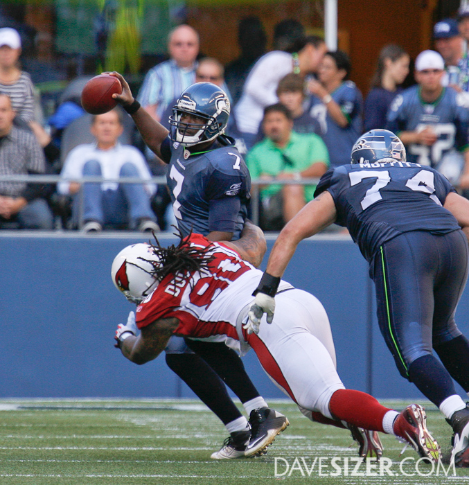 Tarvaris Jackson tries to break free of Darnell Dockett's grip.