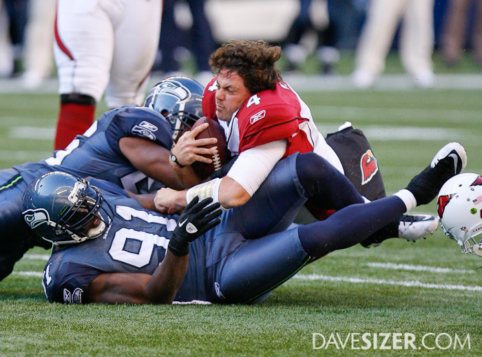 Kevin Kolb loses his helmet when being brought down by Chris Clemons.