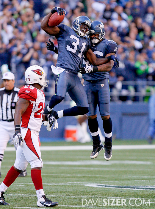 Kam Chancellor made the final interception of the game to seal the victory and celebrates with Leroy Hill.