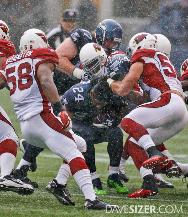 Marshawn Lynch gets his helmet ripped off during the rain storm that showed up at the beginning of the game.