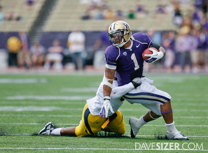 Chris Polk tries to avoid being brought down by a Cal defender.