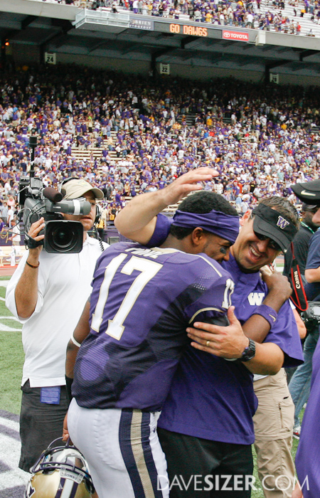 Coach Sark congratulates his QB Keith Price after the win.