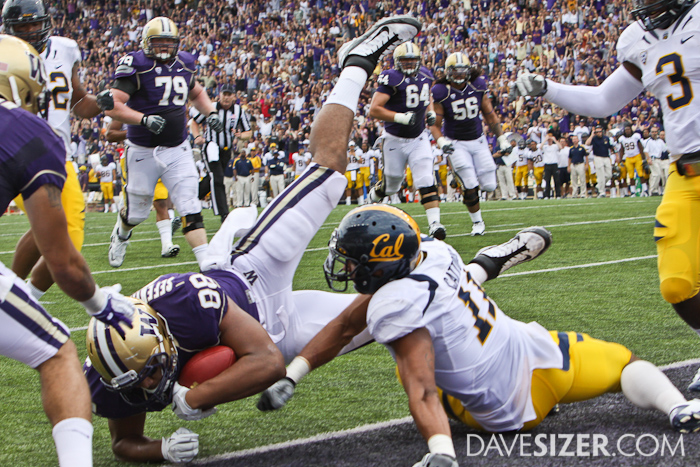 Husky TE Austin Seferian-Jenkins dives into the endzone for a touchdown in the first quarter.