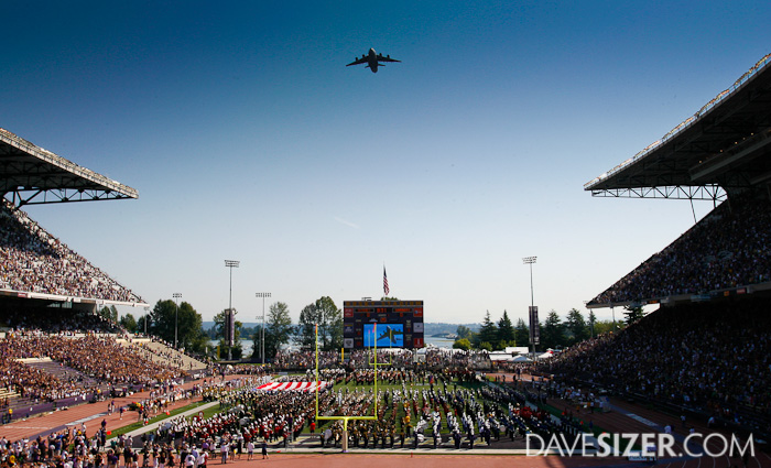 A C-17 flies over Husky Stadium during the National Anthem.