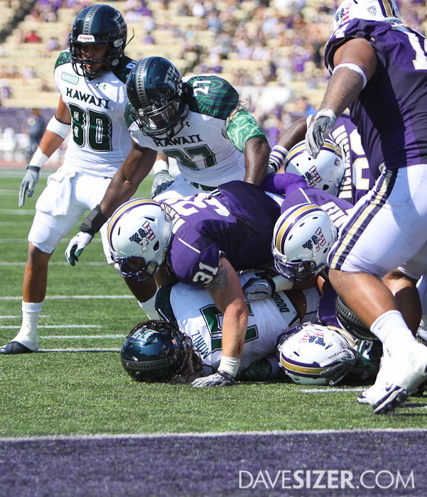 Cort Dennison sacks Hawaii QB Bryant Moiniz on a goal line defense.