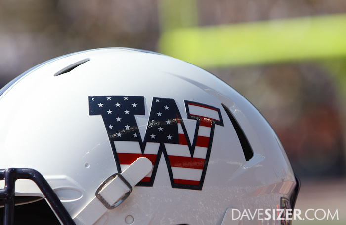 For the 9-11 anniversary, the Huskies wore special helmets with the American Flag in the logo.