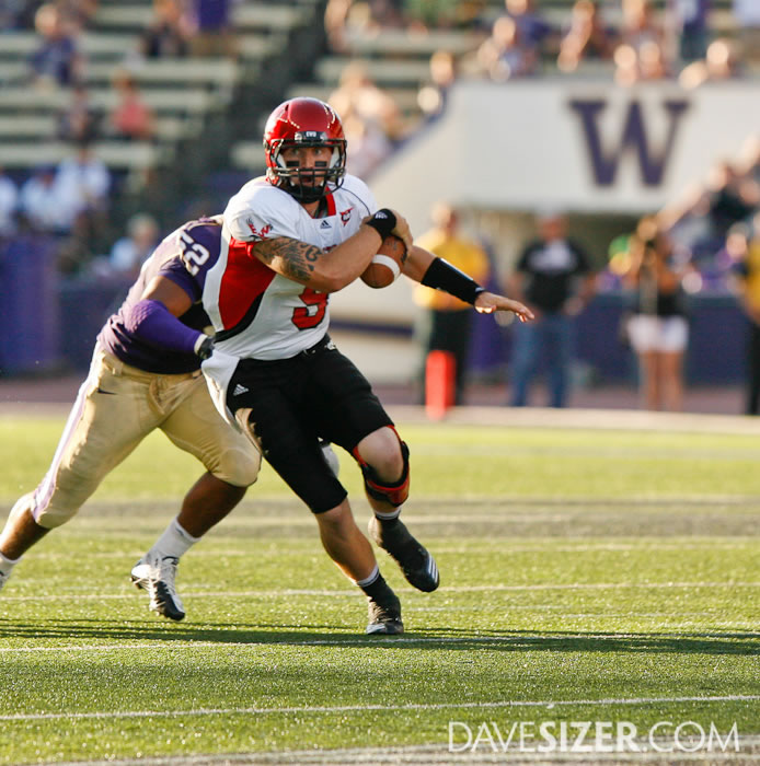 Eastern Washington QB Bo Levi Mitchell tries to escape the defense.