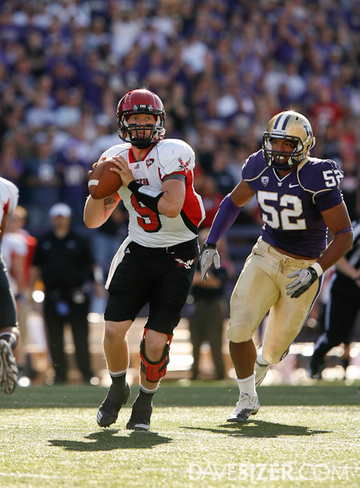 Eastern Washington QB Bo Levi Mitchell looks for a receiver while being tracked down by Hau'Oli Jamora