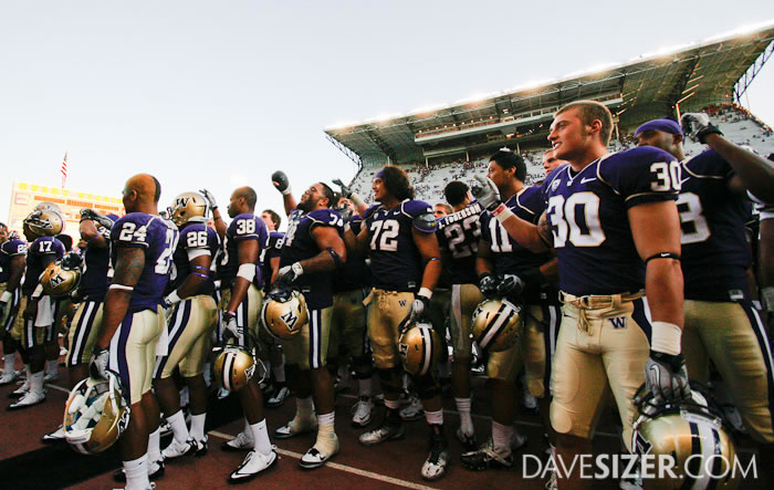 The Huskies sing along with the crowd the fight song after the win.