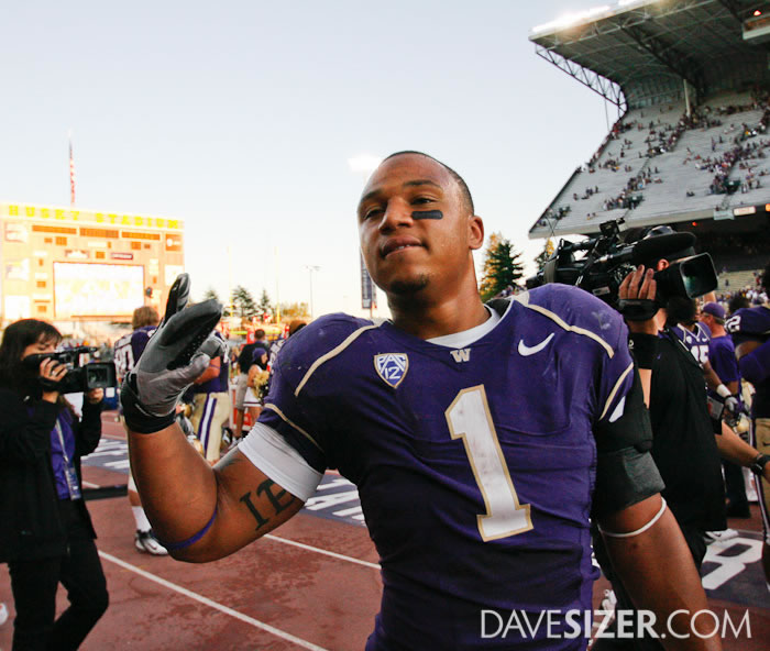 """Chris Polk flashes the """"W"""" to the crowd"""