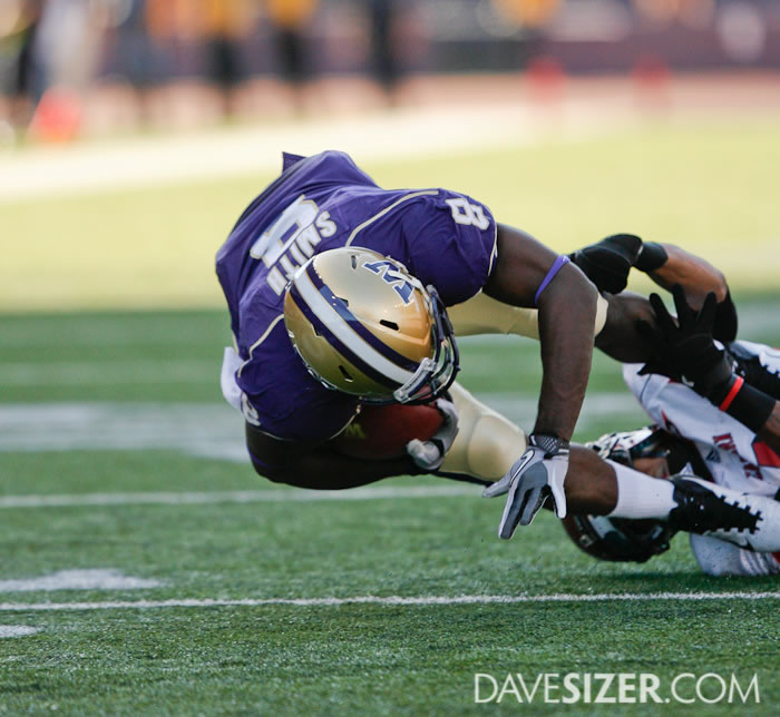 Washington WR Kevin Smith is brought down after a catch.