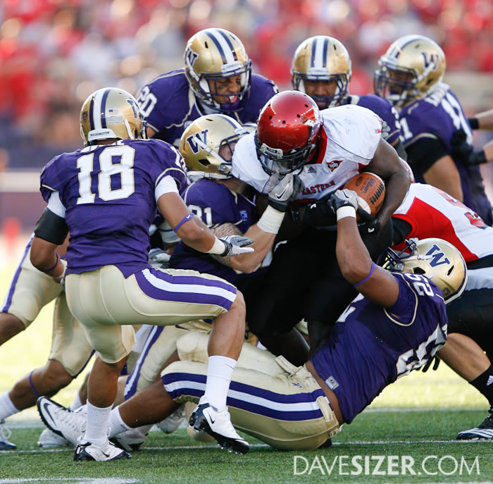 The Washington Defense swarms the EWU runner.
