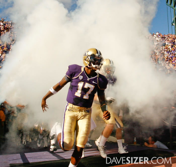 Washington QB Keith Price exits the tunnel through the fog.