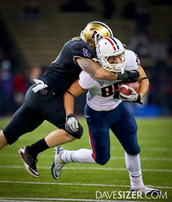 UofA's David Douglas tries to break free from Cort Dennison.