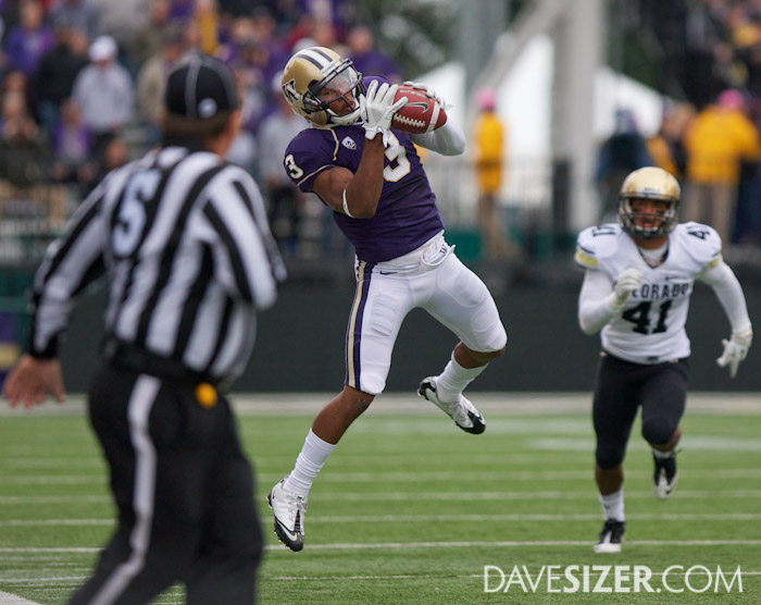 Huskies WR James Johnson hauls in a pass near the sideline on the opening drive of the game.