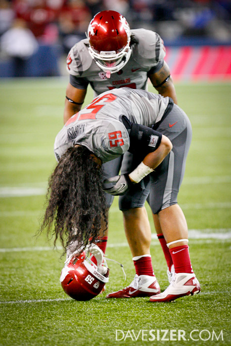 Cougar LB Sekope Kaufusi looses his helmet after a hit.