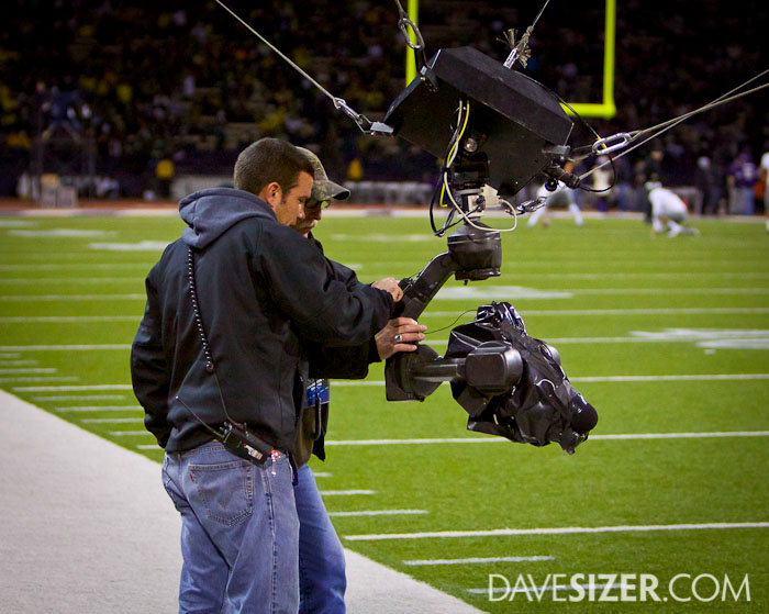 The TV crew adjusting the remote over the field camera during halftime of the Oregon game.