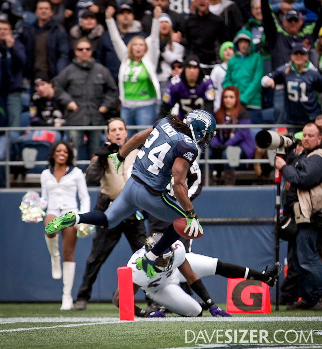 Marshawn Lynch tries to leap for the pylon.