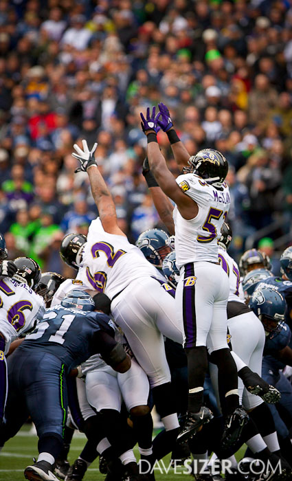 Ravens go high to try and block this field goal attempt.