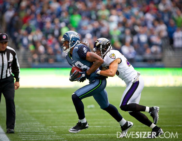 Sidney Rice hauls in a pass with tight coverage.