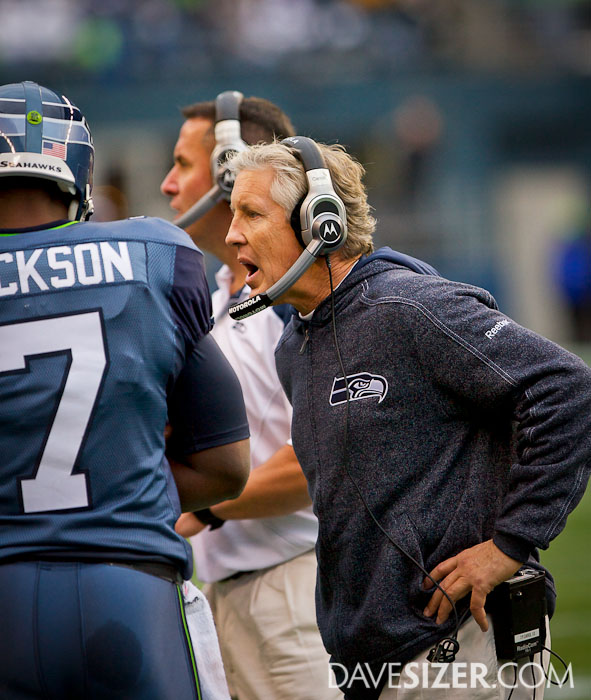 Coach Pete Carroll with some words of encouragement for his quarterback.