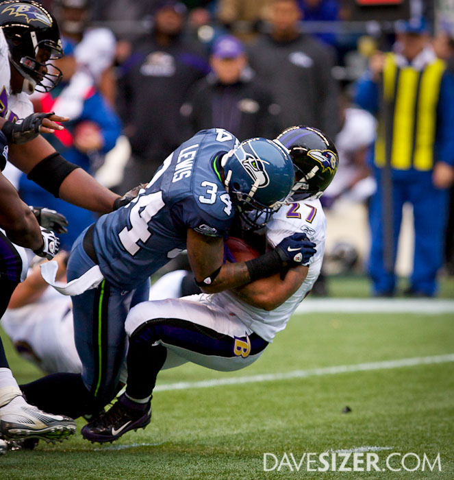 Ray Rice gets knocked back by Roy Lewis.