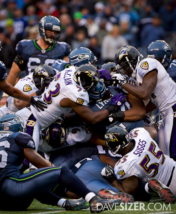 Several Ravens try to wrap up Lynch.