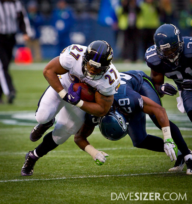 Ray Rice fights for yardage.