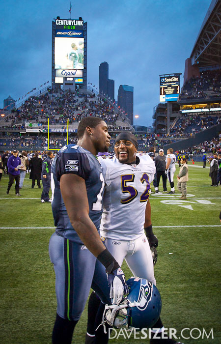 Ray Lewis talks with Mike Williams after the game.