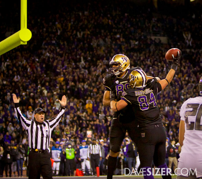 On the next play, he hit Michael Hartvigson for a TD. Here he celebrates with Austin Seferian-Jenkins.
