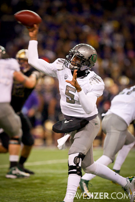 Ducks QB Darron Thomas unloads a pass.