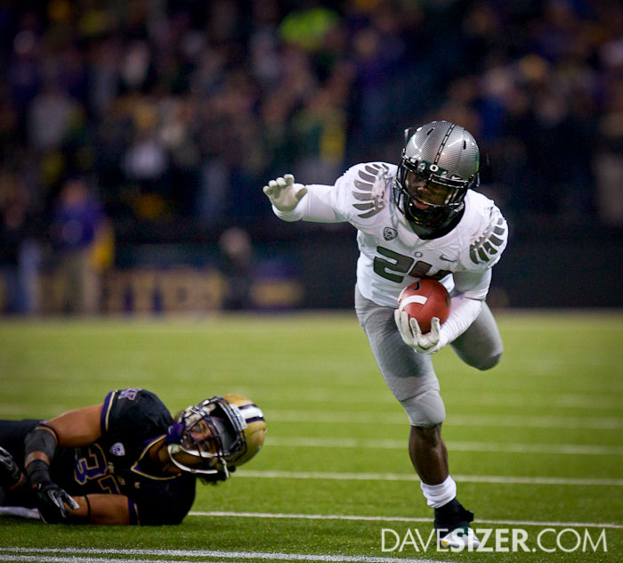 Oregon's Kenjon Barner slips out of the grasp of Princeton Fuimaono.